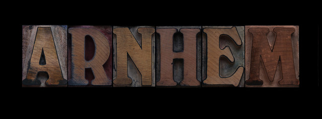 the word Arnhem in old letterpress wood type