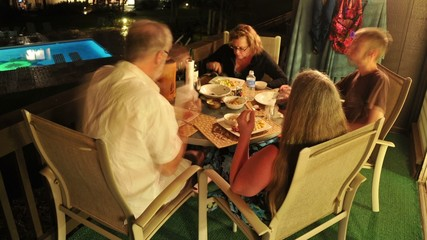 Tourists Eating Dinner on a Hotel Room Balcony