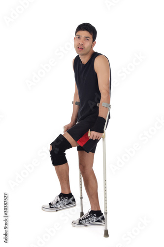 Young nepalese athlete, crutches