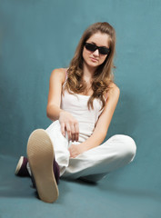 teen girl sitting on grey