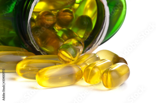 One bottle of omega 3 capsules over white background
