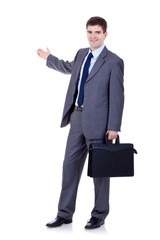 business man with briefcase  presenting
