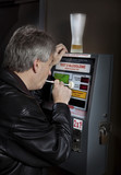 Man taking breathalyzer test at a bar