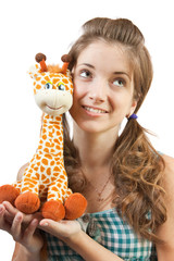 Young girl in green with toy
