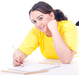 overweight, fat  woman in yellow shirt writing on blank card.