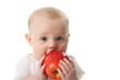 Baby holding apple