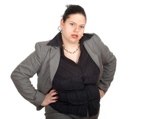 irritated overweight, fat businesswoman in grey suit