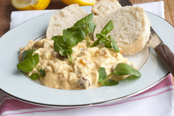 Coronation chicken with watercress and baguette