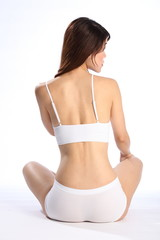 Back view of healthy body of an oriental girl in underwear
