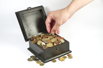 a man stealing coins from a box