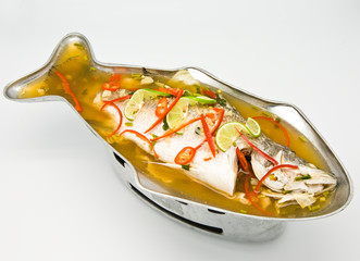 Steamed snapper fish with lemon on white background