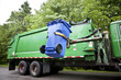 Recycling truck picking up bin