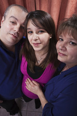 Pregnant young woman with her parents