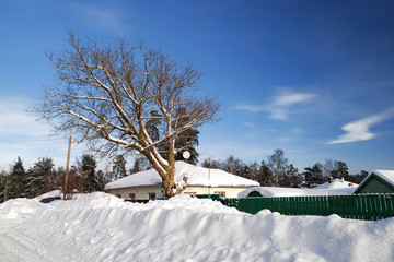 a house in winter with large snowdrifts