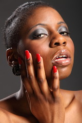 Red nails portrait of beautiful black woman
