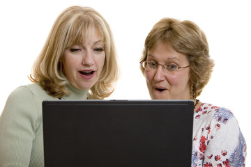 Impressed women looking at computer screen