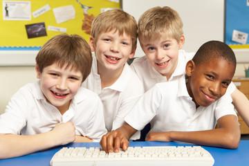 Schoolchildren in IT Class Using Computers
