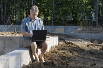 New housing starts man with laptop