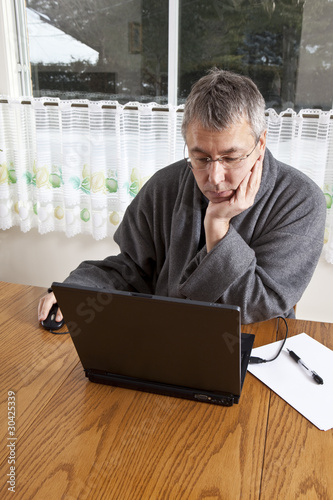 Businessman working from home in pajamas