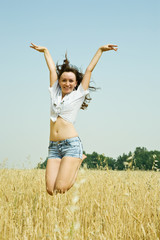 Jumping girl  at field