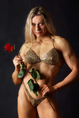 Strong woman with a rose