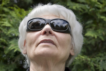Senior woman dark glasses