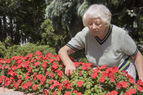 Senior woman flower garden