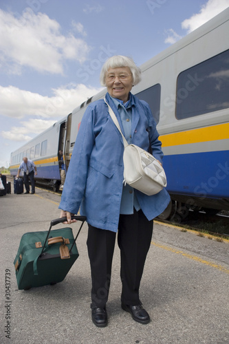 Senior woman train travel