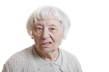 Senior woman studio portrait disappointed