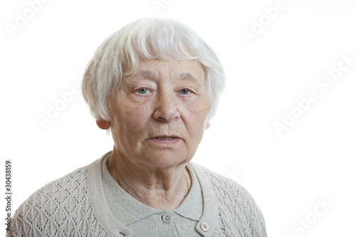 Senior woman studio portrait serious