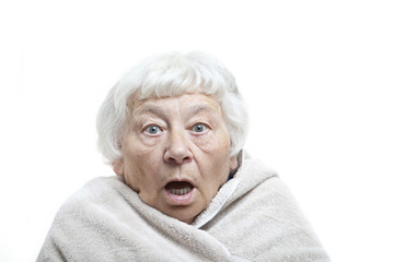 Shocked senior woman with a towel