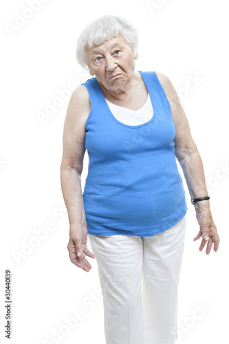 Unimpressed senior woman studio portrait