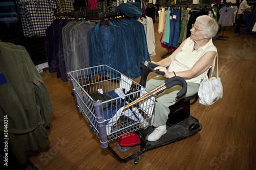 Senior woman shopping with a buggy
