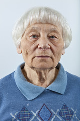 Serious senior woman head and shoulders portrait