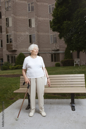 Senior woman waiting at a bus stop