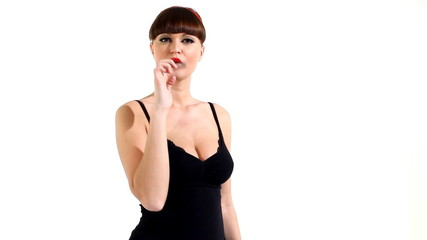 Woman in lingerie eat chewing gum and blow bubble