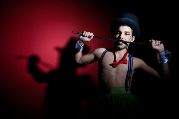 Performer in top hat with whip