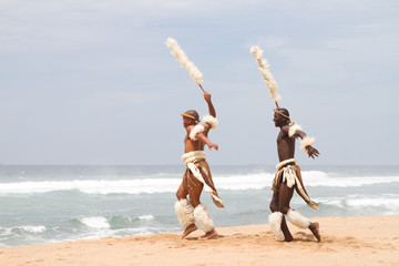 african dancers on beach
