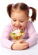 Little girl licks fruit salad