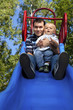 Father and son on a slide in a park