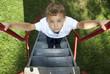 Boy climbing a slide in a park
