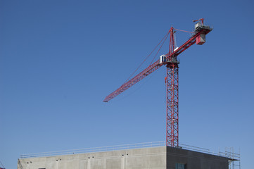Construction crane above a new structure