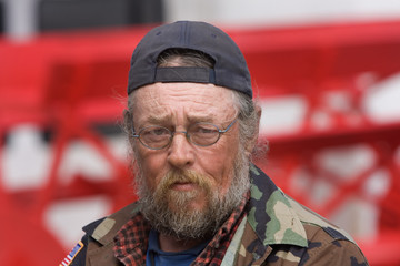 Old Homeless Man Wearing Glasses