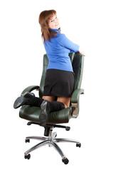 Businesswoman  kneeling on chair