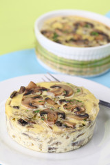Mushroom gratin with eggs and cheese, garnished with parsley