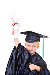 Young boy in graduation gown