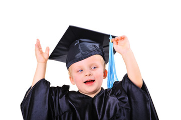 Cute little boy in graduation dress