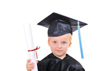 Cute little boy in graduation dress