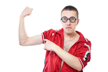 Portrait of a young nerd in funny glasses showing his muscles