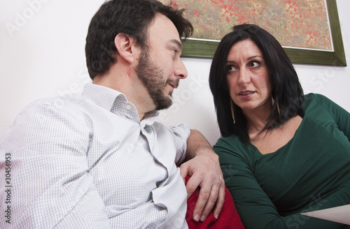 Portrait of Adult Couple Relaxing on Sofa at Home